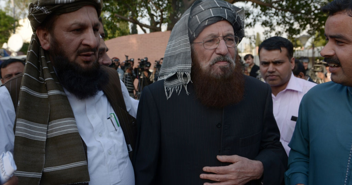 Pakistani members of the negotiating committee from the Tehreek-e-Taliban Pakistan (TTP) Maulana Sami ul Haq (2L) and Mualana Yousaf Shah (L) leave after briefing media following a meeting of the negotiation committee in Islamabad on March 22, 2014.</p>
