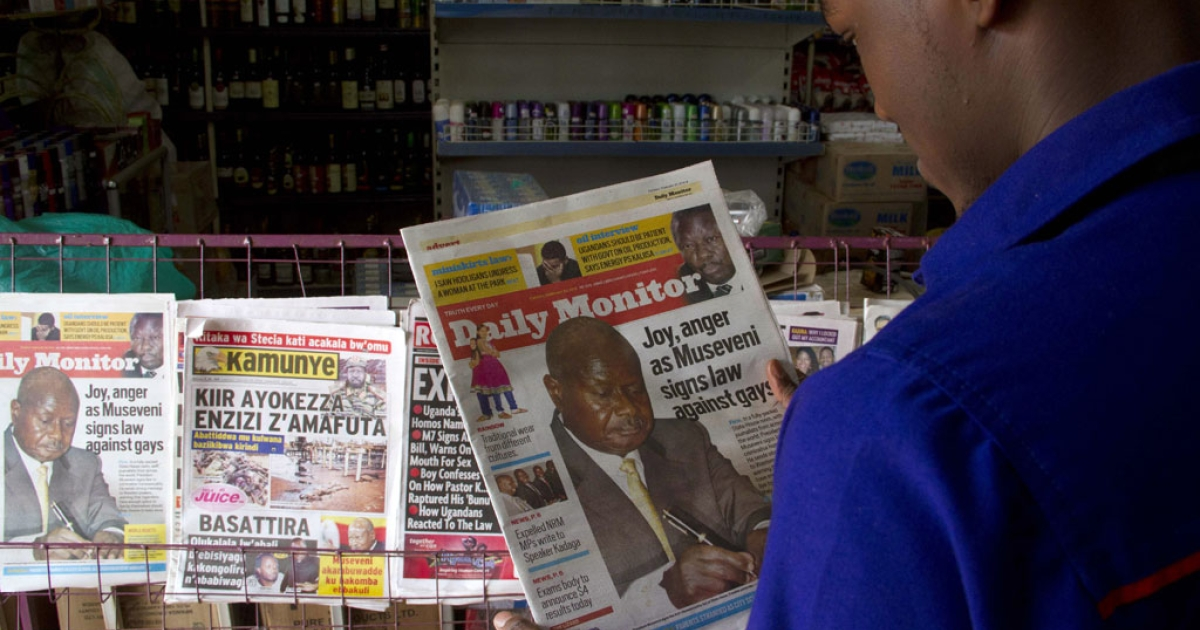 A man reads one of Uganda's local dailies in Kampala on Feb. 25, 2014. A Ugandan newspaper listed on February 25, 200 people it accused of being gay, a day after the president called homosexuals 'mercenaries' and signing one of the world's toughest anti-gay laws.</p>
