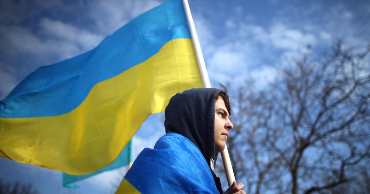 A pro-Ukrainian protester walks along the road on March 14, 2014 in Simferopol, Ukraine.</p>
