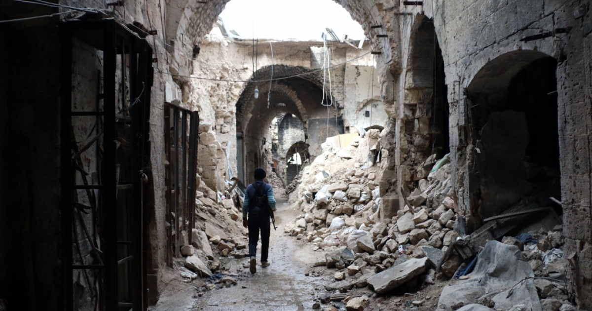 A rebel fighter walks in a devastated alley of Aleppo's old market, in the UNESCO-listed northern Syrian city on February 27, 2014. Some 3,300 people have been killed in fighting between rebels seeking President Bashar al-Assad's ouster and their erstwhile jihadist allies since clashes erupted in January, a monitoring group said on february 26, 2014.   AFP PHOTO / AMC / ZEIN AL-RIFAI        (Photo credit should read ZEIN AL-RIFAI/AFP/Getty Images)</p>