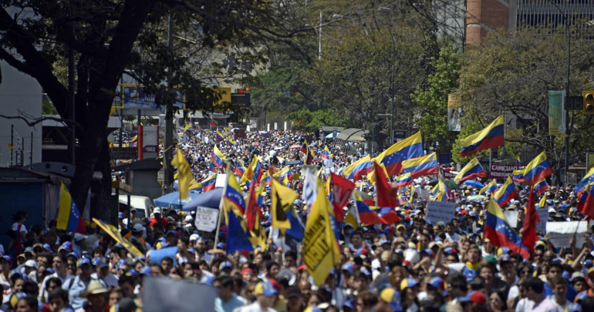 Opposition demonstrators take part in a protest against the government of Venezuelan President Nicolas Maduro in Caracas on March 4, 2014.</p>