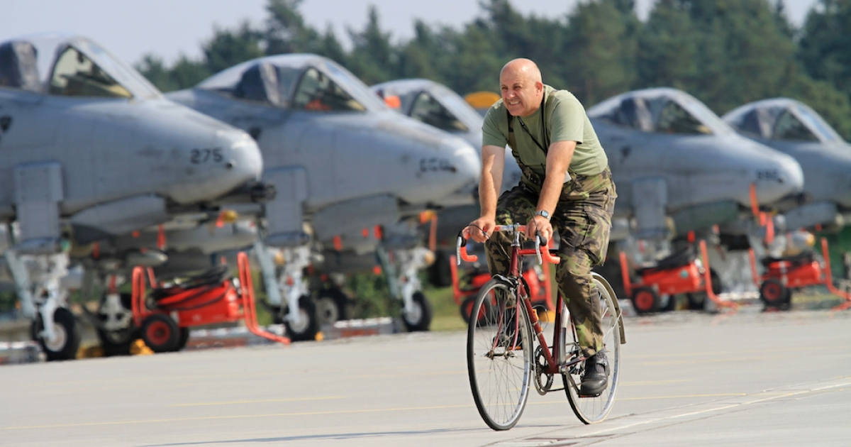 A soldier rides past Air Force A-10 Thunderbolt airplanes, better known as
