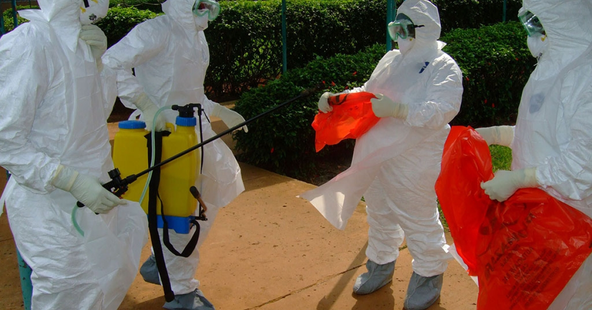 Officials from the World Health Organization wear protective clothing on July 28, 2012 as they prepare to enter Kagadi Hospital in Kibale District in Uganda, where an outbreak of Ebola virus started.</p>