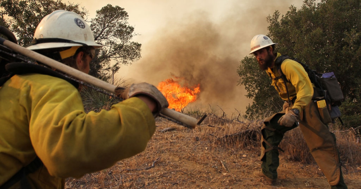 Firefighters with the Type 1 Interagency Hotshot Crew (IHC), based out of the Lone Peak Conservation Center, in Draper, Utah, build a fire break as the Springs fire continues to grow on May 3, 2013 near Camarillo, California.</p>