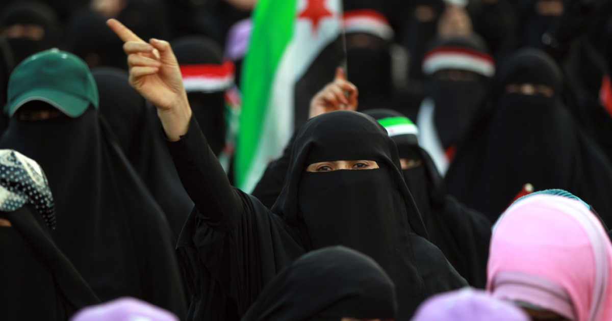 A Yemeni woman holds up her finger during a rally marking the first anniversary of the ouster of autocratic leader Ali Abdullah Saleh on Feb. 21, 2013, in the Yemeni capital Sanaa.</p>