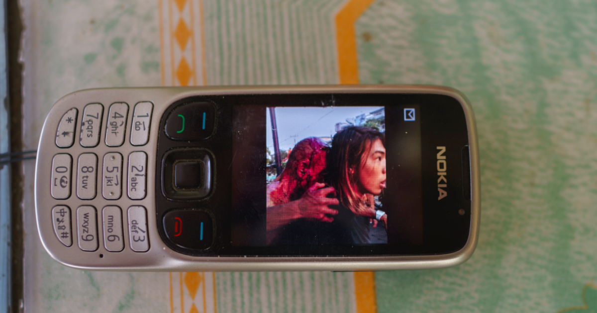 A photo on a Buddhist monk's phone shows the monk fatally injured after a dispute in a gold shop in Meikhtila's main market on March 21st, 2013. The incident triggered riots that cost 40 lives and eventually spread across Myanmar. (Ruben Salgado Escudero/GlobalPost)</p>