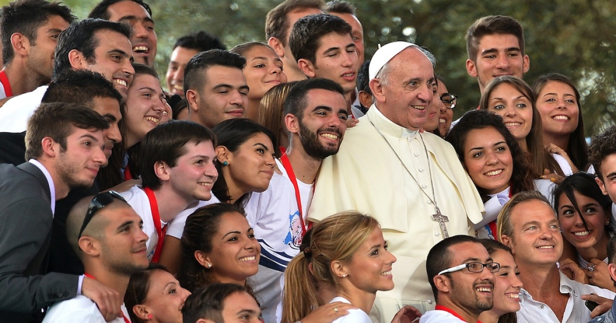 Pope Francis poses with participants at the end of a meeting with young people entitled
