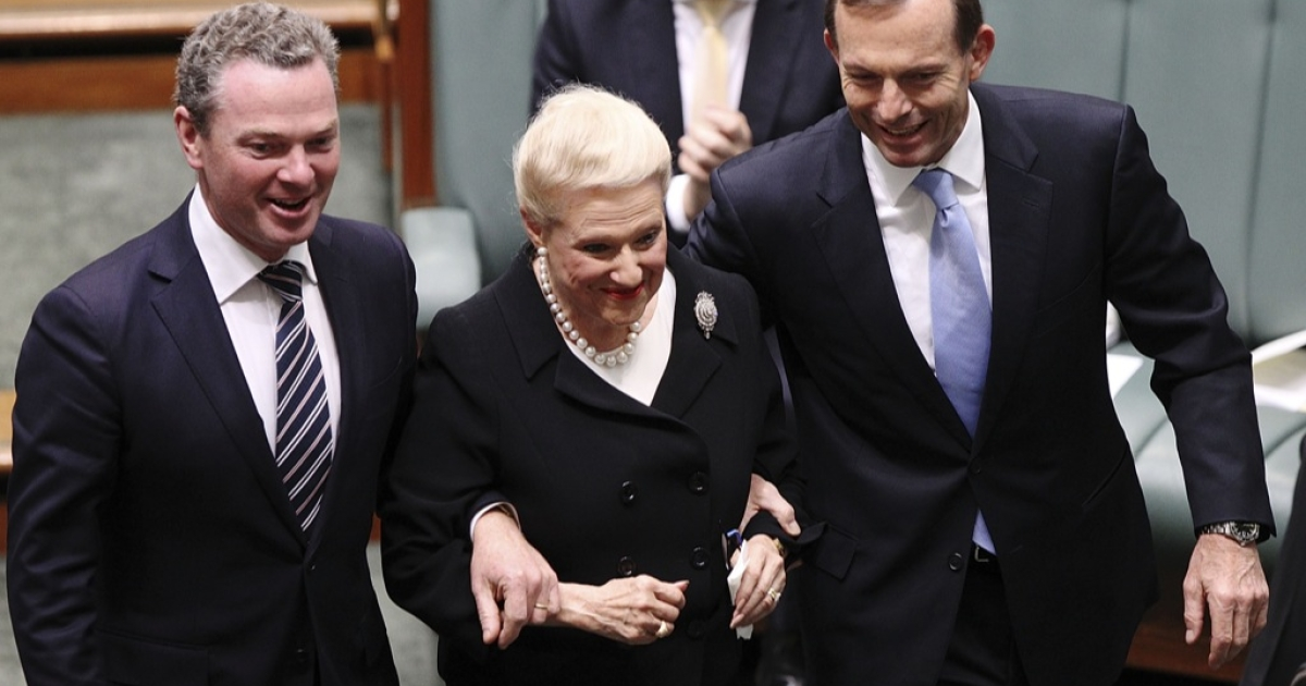 They aren't always like this: Christopher Pyne and Tony Abbott escort Bronwyn Bishop to her chair in the House of Representatives.</p>