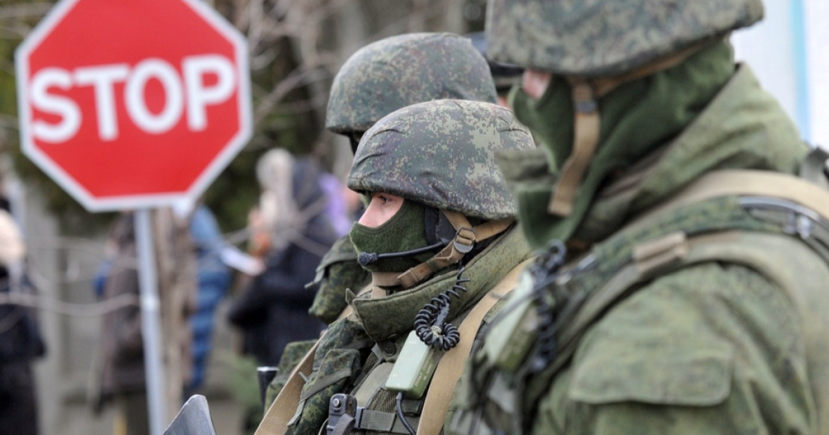 Armed uninformed militants block access to a Ukrainian border base.</p>