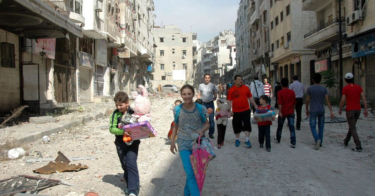 Syrians return to the Christian Hamidiyeh neighbourhood of the old town of Syria's central city of Homs.</p>