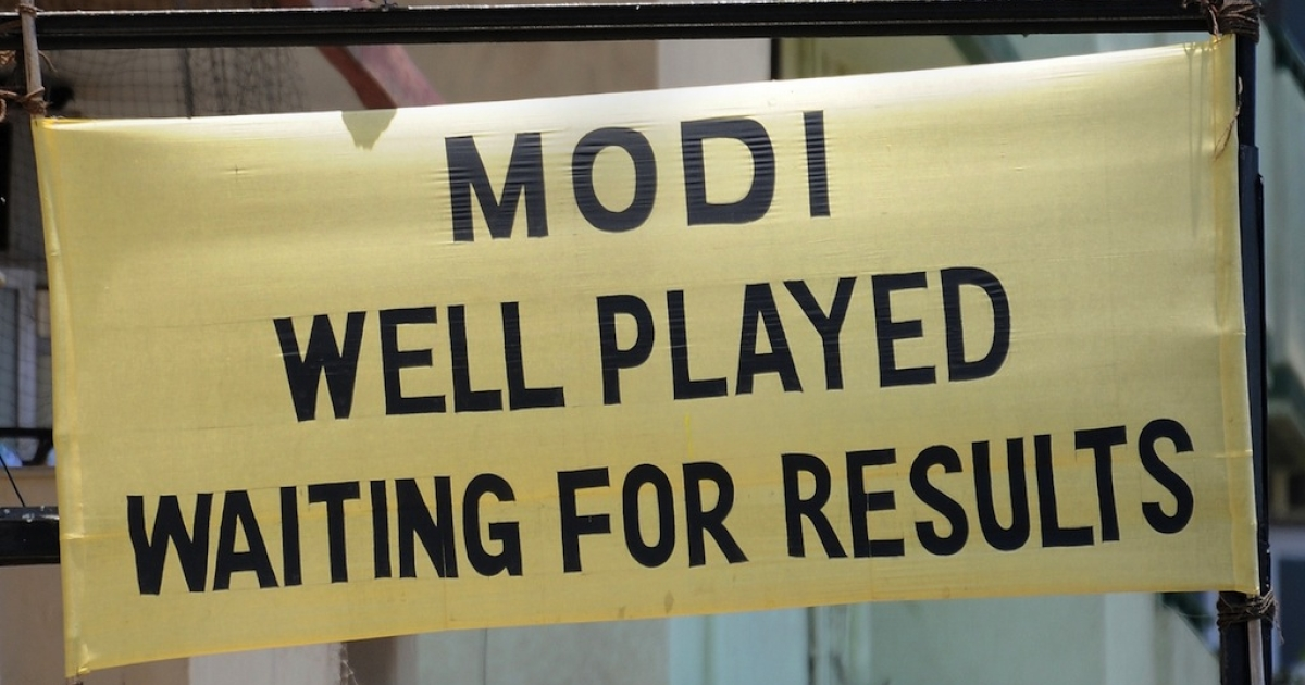 A banner applauding Bharatiya Janata Party (BJP)'s prime ministerial candidate Narendra Modi at a busy intersection in Mumbai on May 13, 2014.</p>