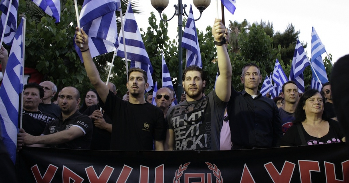Supporters of the Greek ultra nationalist party Golden Dawn I during a pre-election rally on May 23, 2014 in Athens, Greece. Greeks go to polls on Sunday for the European elections and the second round of the local elections.</p>