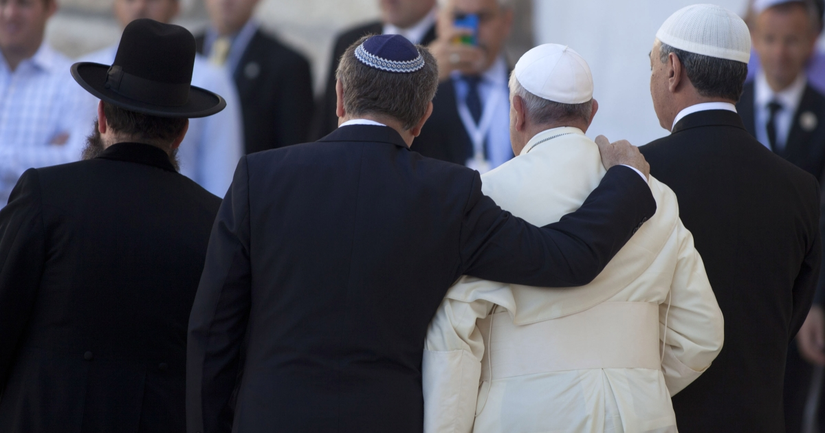 Pope Francis and Rabbi Skorka, center, leave the Western Wall compound, with Omar Abboud at far right.</p>