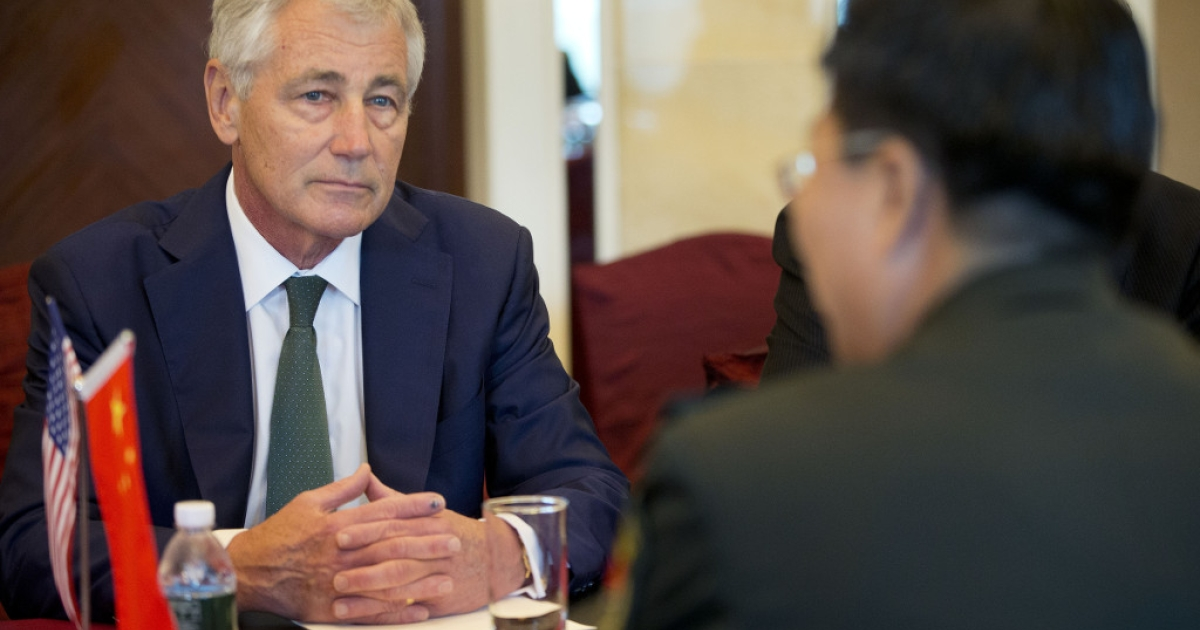 US Defense Secretary Chuck Hagel listens to Lt. Gen. Wang Guanzhong, China's deputy chief of general staff, speak at the start of their meeting on May 31, 2014 in Singapore.</p>