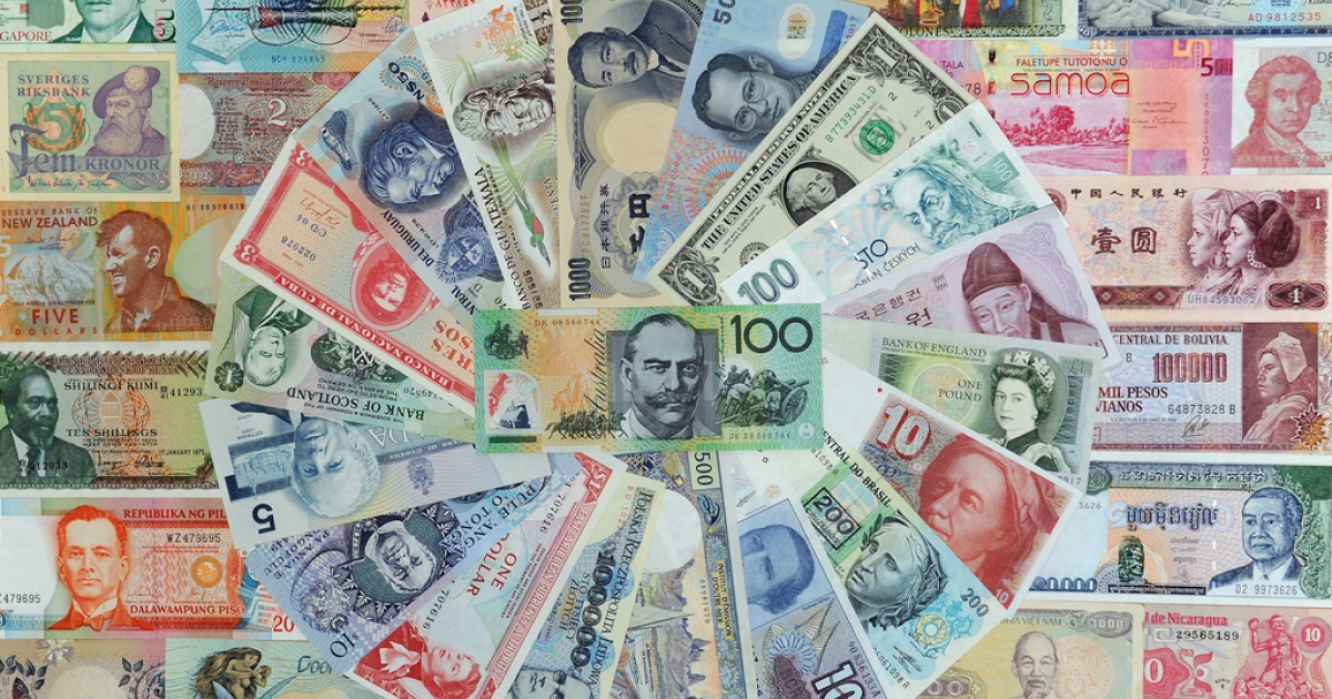 A 100 Australian dollar note and other foreign currencies.</p>