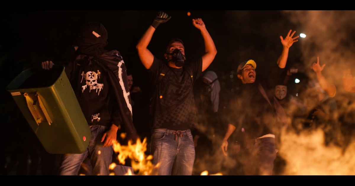 Black Bloc protesters clash with police during a rally against the World Cup on May 15 in Sao Paulo, Brazil.</p>