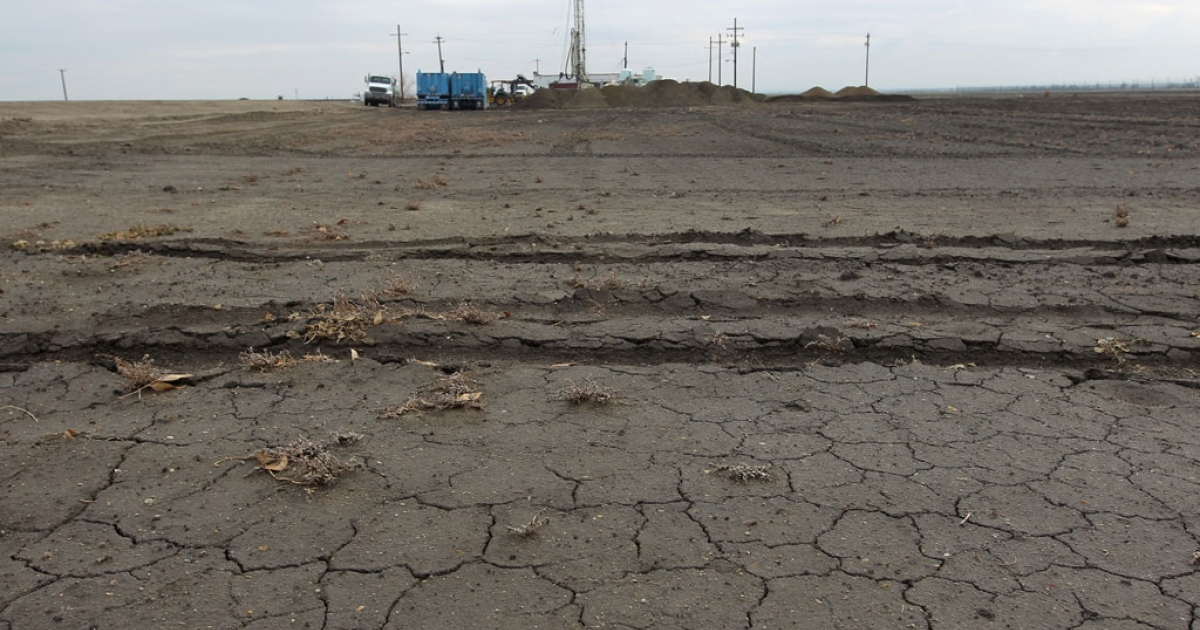 Workers drill for water for a farmer on Feb. 6, 2014 near Bakersfield, California.</p>