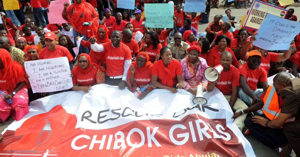 Members of civil society groups protest the abduction of Chibok schoolgirls in Abuja on May 6, 2014.</p>