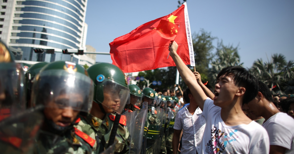 Chinese police confront anti-Japanese demonstrators irate about the disputed Diaoyu Islands, in September 2012 in Shenzhen. But 25 years after Tiananmen, will protesters ever rise up en masse against the Communist Party?</p>