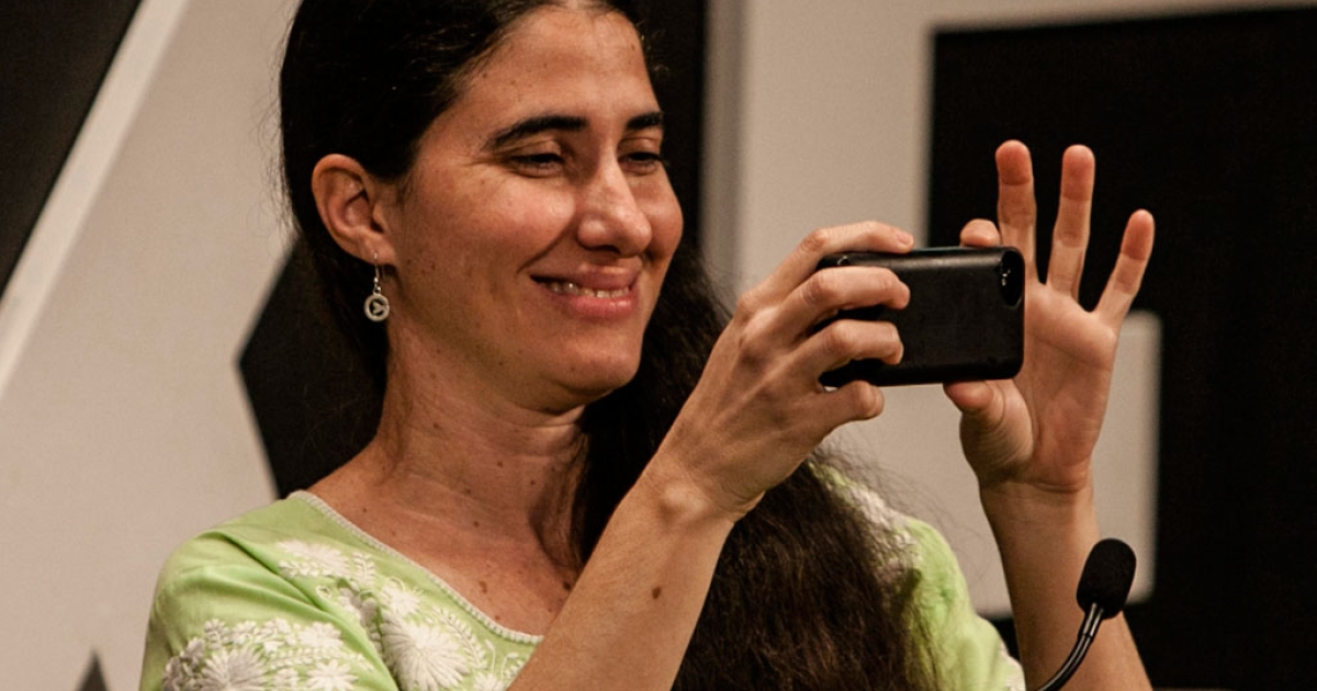 Cuban blogger Yoani Sanchez takes a snapshot during a conference in Colombia on Jan. 31, 2014.</p>
