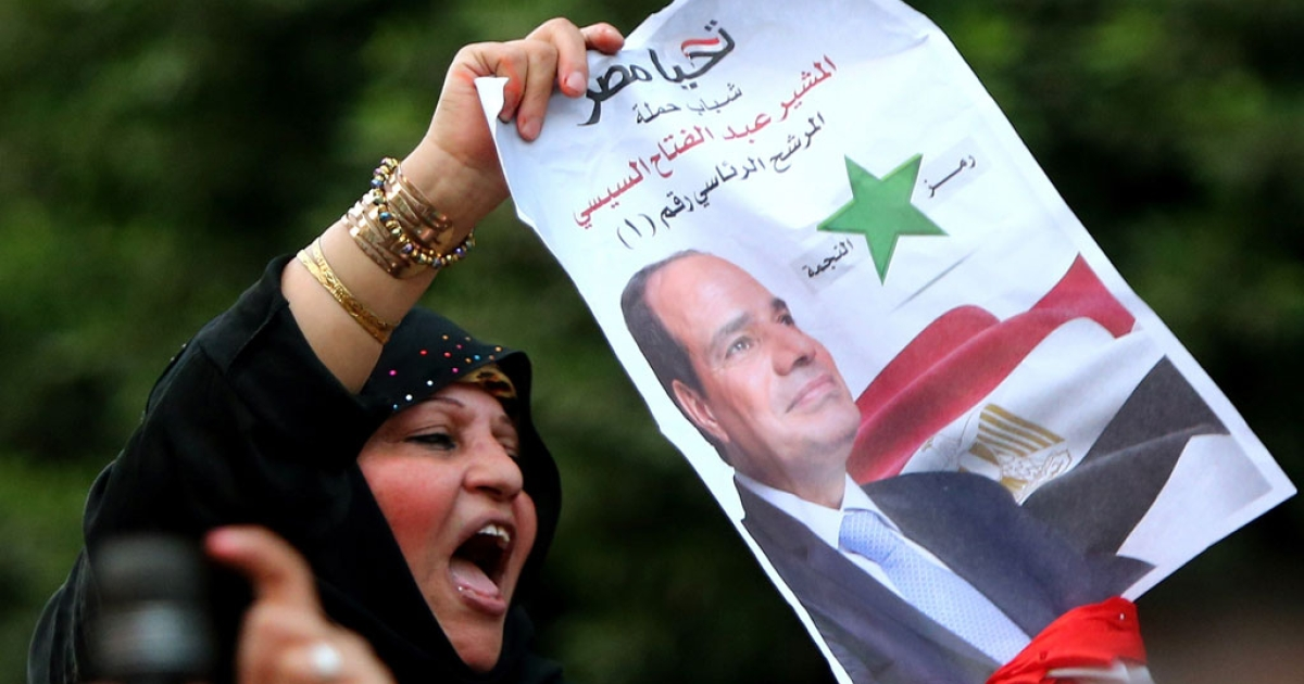 A supporter of former army chief Abdel Fatah al-Sisi chants slogans in a street in Cairo on the second day of Egypt's presidential election on May 27, 2014.</p>