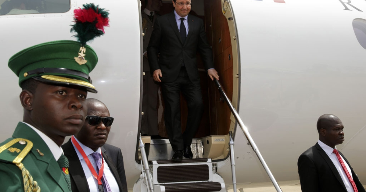 French President Francois Hollande disembarks his plane after arriving at Abuja airport on Feb. 27, 2014.</p>