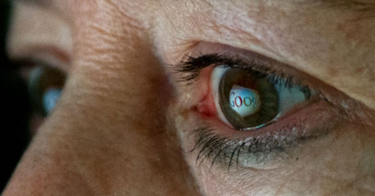 A photo illustration showing Google's logo reflected in a woman's eye.</p>