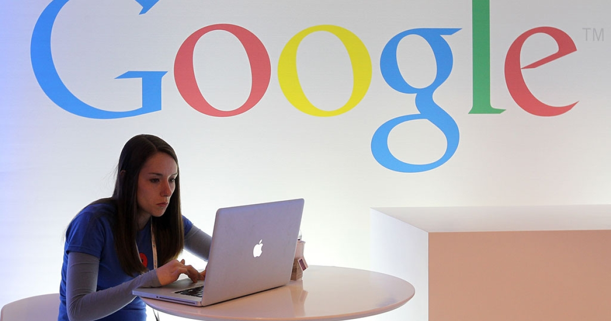 A Google employee works on a laptop before the start of a conference on June 6, 2012 in San Francisco, California.</p>