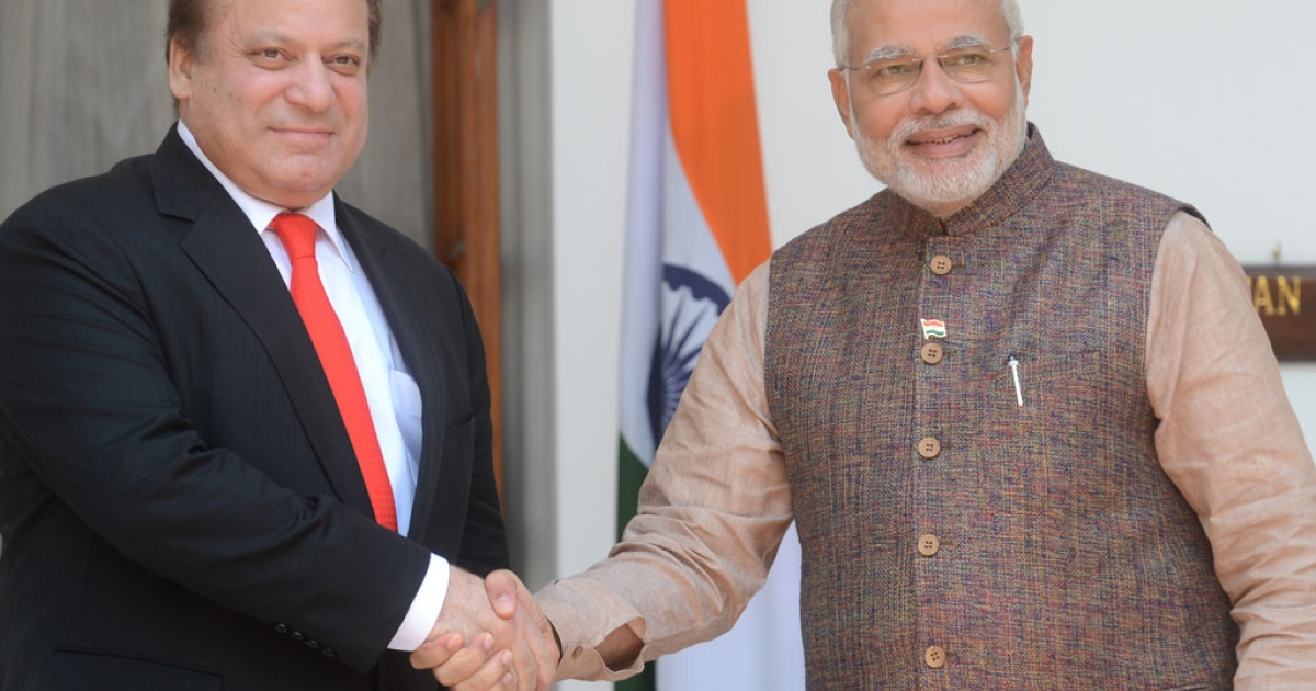 India's newly sworn-in Prime Minister Narendra Modi shakes hands with Pakistani Prime Minister Nawaz Sharif during a meeting in New Delhi on May 27, 2014.</p>