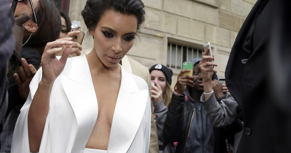 American reality TV star Kim Kardashian leaves her residence in Paris on May 23, 2014, ahead of their wedding.</p>