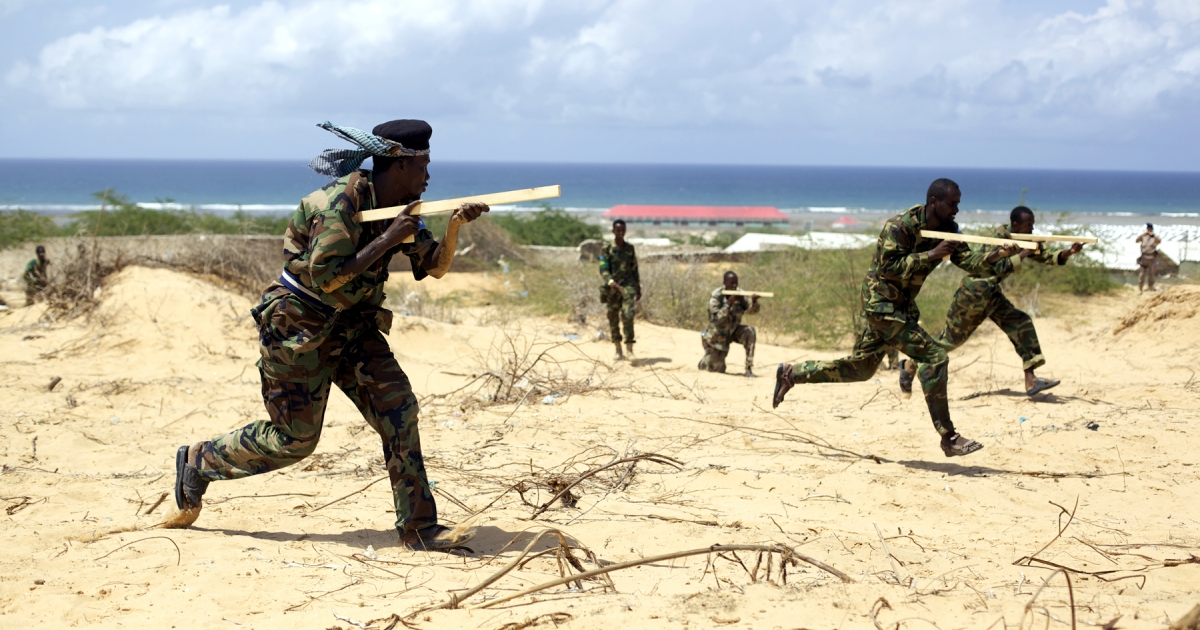 Somali National Army troops are trained by European Union soldiers in Jazeera, Mogadishu</p>