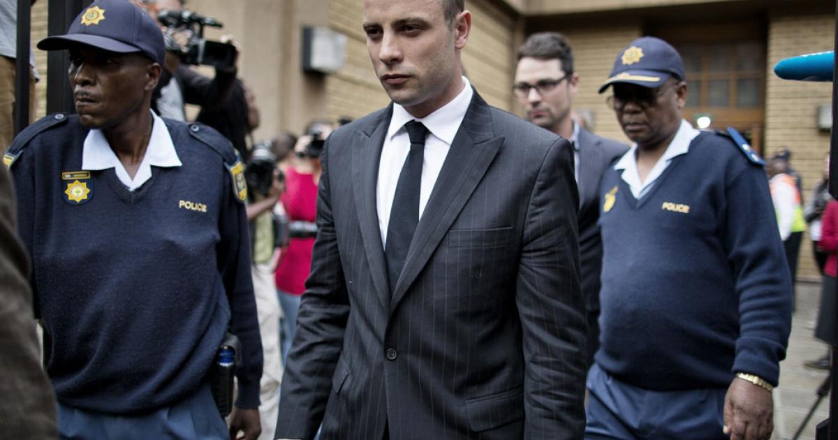 Oscar Pistorius (C) leaves the North Gauteng High Court on April 16, 2014 in Pretoria.</p>