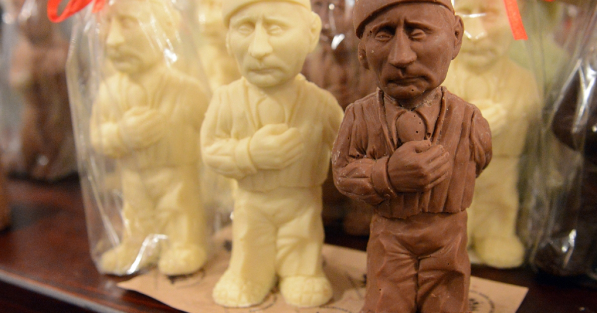 Chocolate figurines depicting Russian President Vladimir Putin are on sale in a store of Lviv Workshop of Chocolate, on May 15, 2014 in the historical tourists center of the western Ukrainian city of Lviv. AFP PHOTO/ YURIY DYACHYSHYN        (Photo credit should read YURKO DYACHYSHYN/AFP/Getty Images)</p>