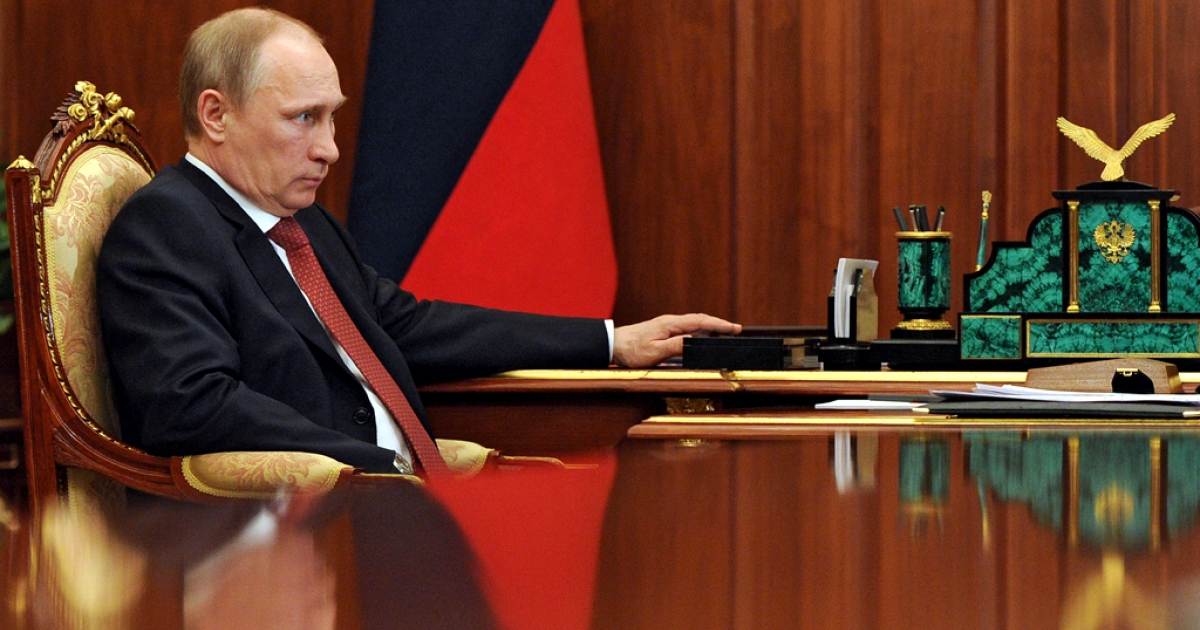 Russia's President Vladimir Putin attends a meeting in the Kremlin in Moscow, on May 5, 2014.</p>