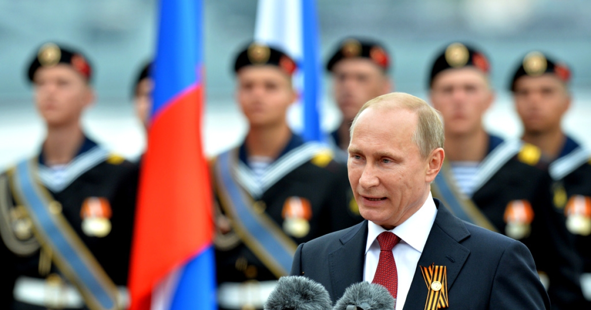 Russian President Vladimir Putin speaks during his visit to the Crimean port of Sevastopol on May 9, 2014.</p>