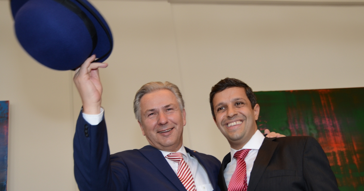 Saleh (R) with Wowereit at a reception for the mayor's 60th birthday. A present from Saleh, the hat means Wowereit's the boss... for now at least.</p>