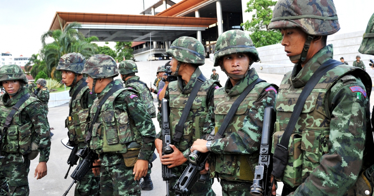 Thai army soldiers secure the grounds of the venue for peace talks between pro- and anti-government groups on May 22, 2014 in Bangkok, Thailand.</p>