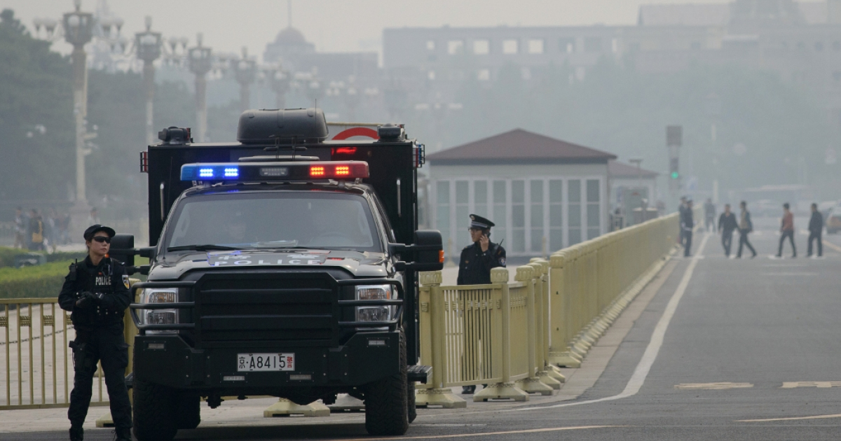 Armed police stand guard at Tiananmen Square in Beijing on Oct. 31, 2013.</p>