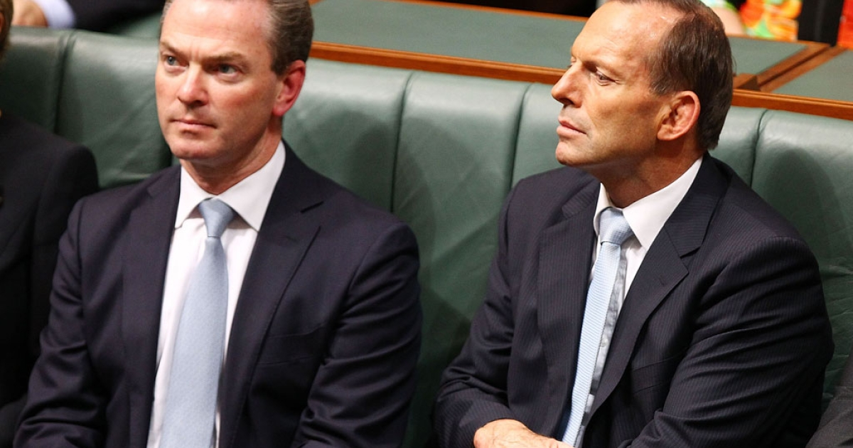 Prime Minister Tony Abbott listens to Treasurer Joe Hockey deliver his first budget speech in the House of Representatives at Parliament House on May 13, 2014 in Canberra, Australia.</p>