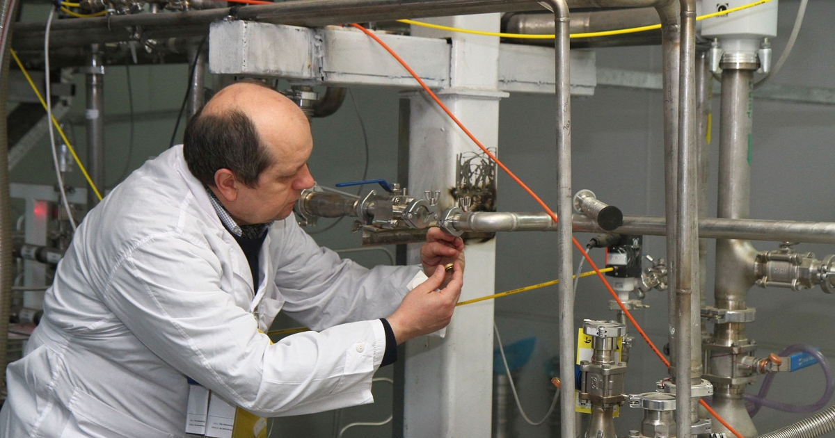 An unidentified International Atomic Energy Agency (IAEA) inspector disconnects the connections between the twin cascades for 20 percent uranium production at nuclear power plant of Natanz, as Iran halted production of 20 percent enriched uranium according to the terms of an interim deal with world powers on its disputed nuclear program.</p>