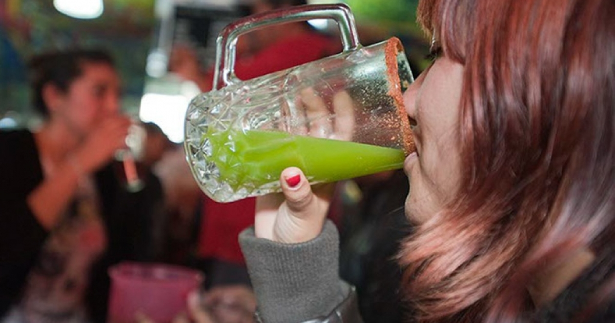 Once the drink of only Mexican country folk and urban construction workers, pulque, the fermented nectar of the maguey cactus, has found acceptance today among students and hipsters. This Mexican student enjoys a glass of celery-flavored pulque.</p>
