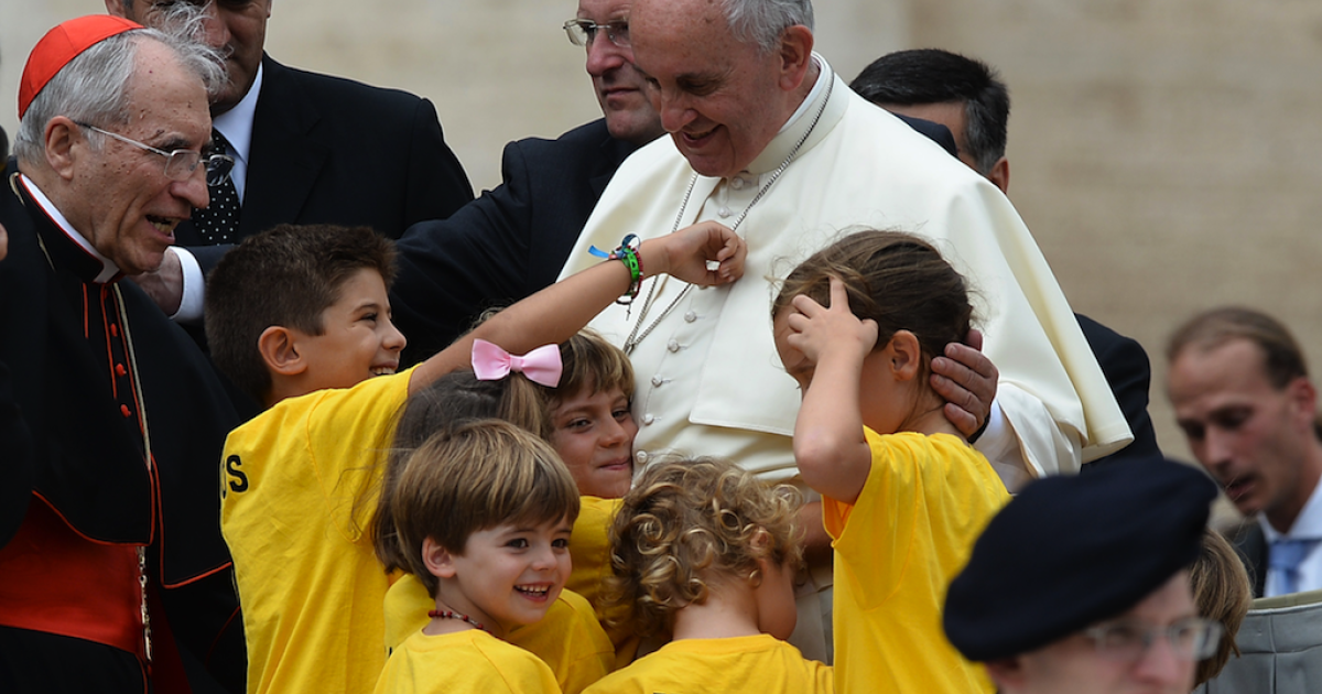 Pope Francis greets children at the end of his general audience at St Peter's Square on June 25, 2014 at the Vatican.</p>