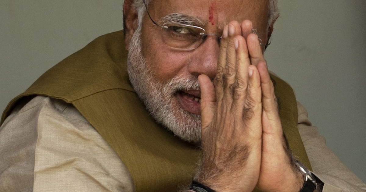 BJP leader Narendra Modi gestures to supporters in Ahmedabad, India on May 16, 2014 as initial vote tallies pointed to a landslide for Modi and his party.</p>