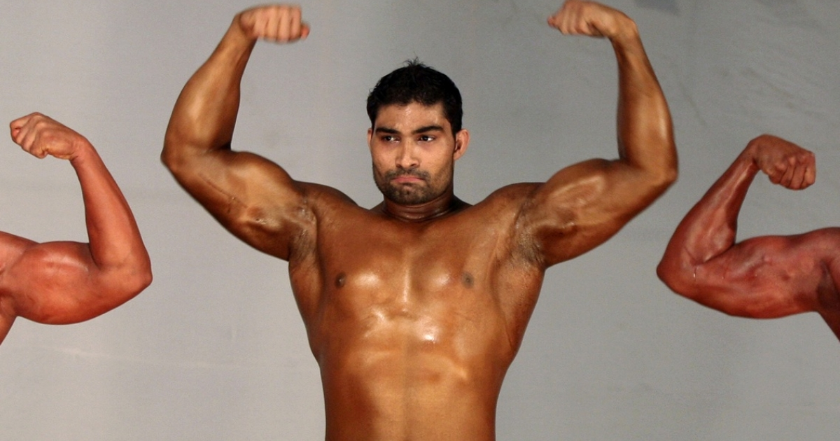 A competitor flexes his muscles during the