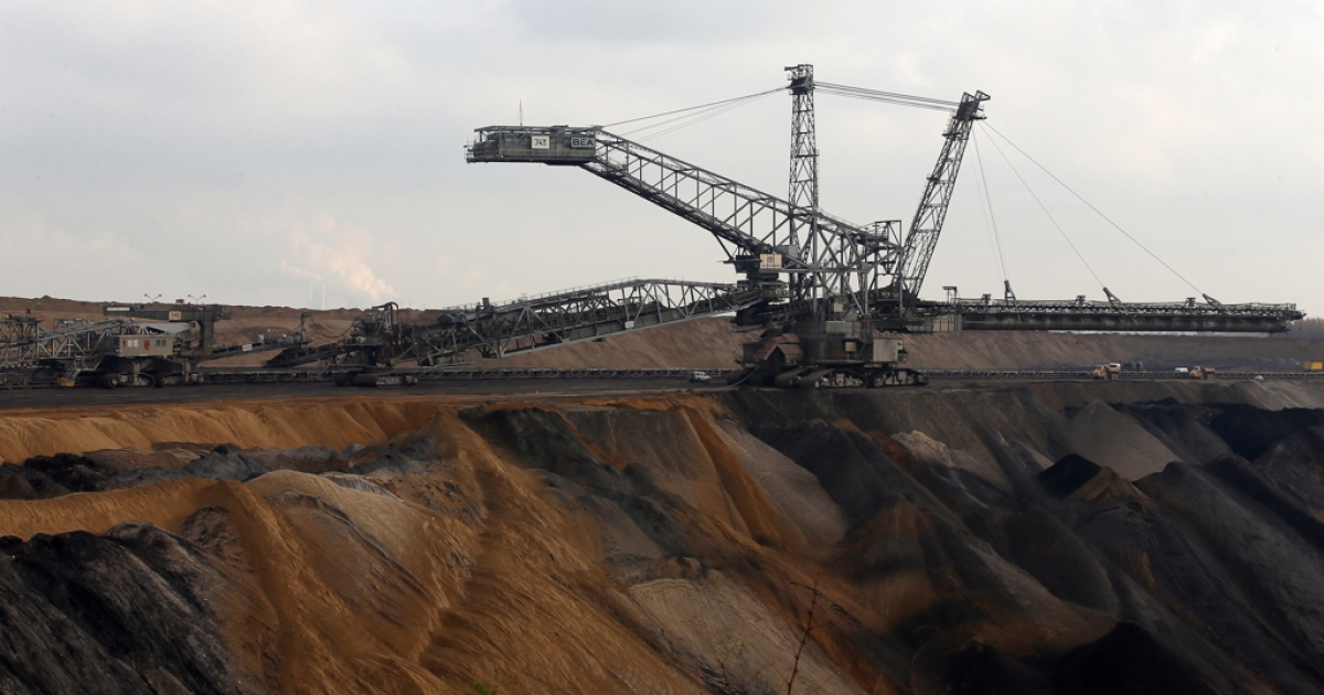 Bucket excavators dig lignite coal out of the ground at the Garzweiler open-pit coal mine at Jackerath view point on November 19, 2013 near Bergheim, Germany.</p>