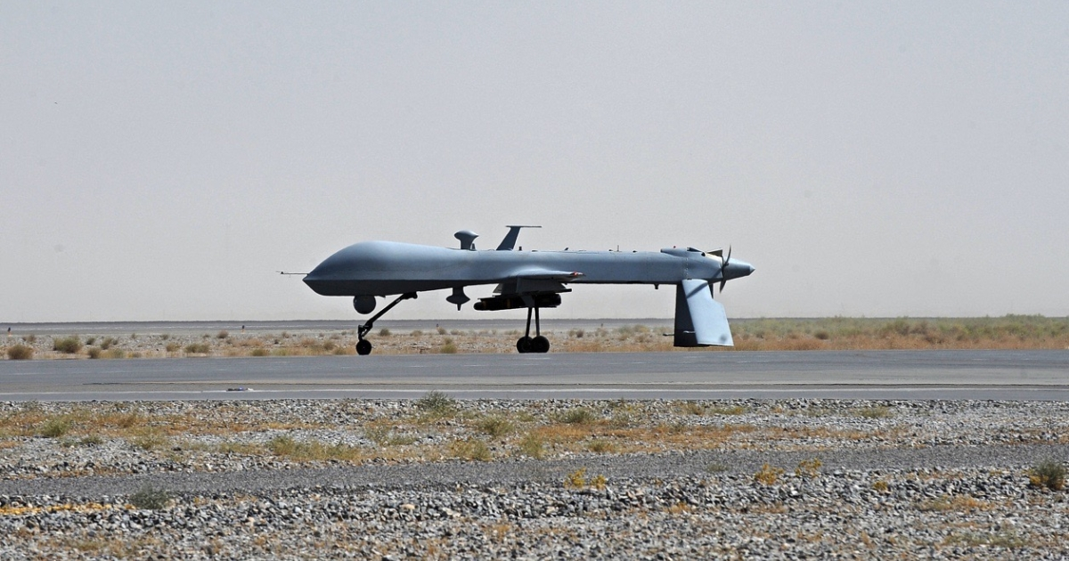 A US Predator drone armed with a missile stands on the tarmac in Afghanistan.</p>