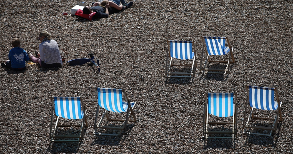People enjoy spring sunshine on the seafront on April 22, 2015 in Brighton, England. Parts of the United Kingdom are experiencing warm sunny weather.</p>