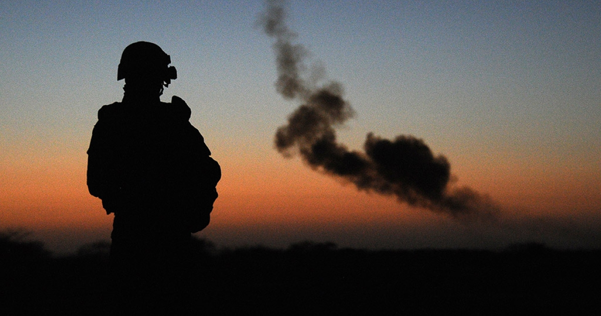 A French soldier watches a controlled explosion of an artisanal bomb and other munitions by a bomb-disposal expert on February 14, 2013 found by the French army in Gao, in northern Mali. <br />  </p>