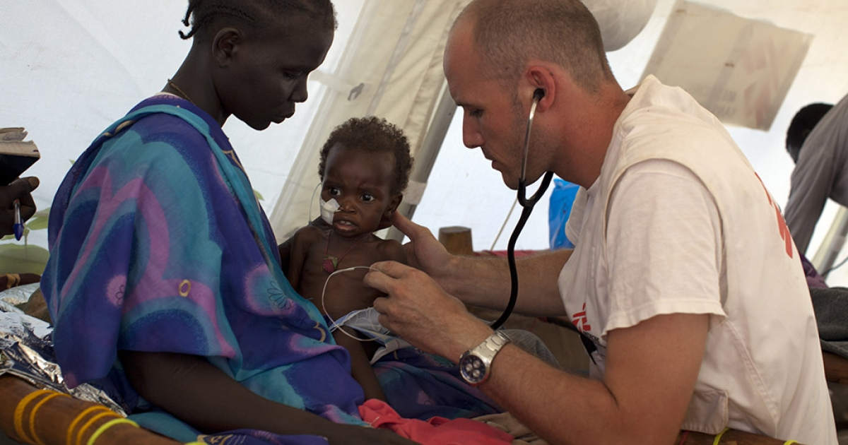 Dr. Emmanuel Berbain examines a young patient at the Medecins Sans Frontieres hospital at the Yida refugee camp along the border with North Sudan July 3, 2012 in Yida, South Sudan.</p>