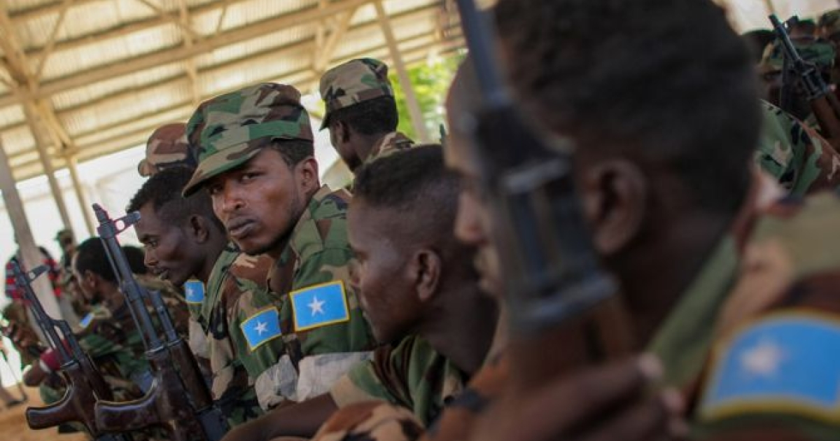 Recently trained members of the Somali National Army (SNA) sitting during a passing-out parade at an African Union Mission in Somalia (AMISOM) training facility on the western fringes of Mogadishu. The SNA has helped liberate large areas and towns of strategic importance across Somalia from the Al-Qaeda-affiliated terrorist group Al Shabaab.<br /> </p>